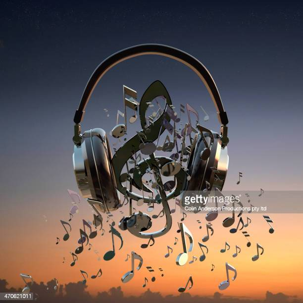 Headphones blaring musical notes