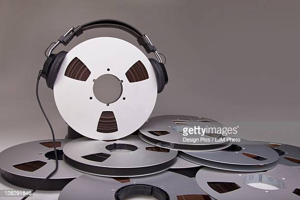 headphones on a reel of recording tape