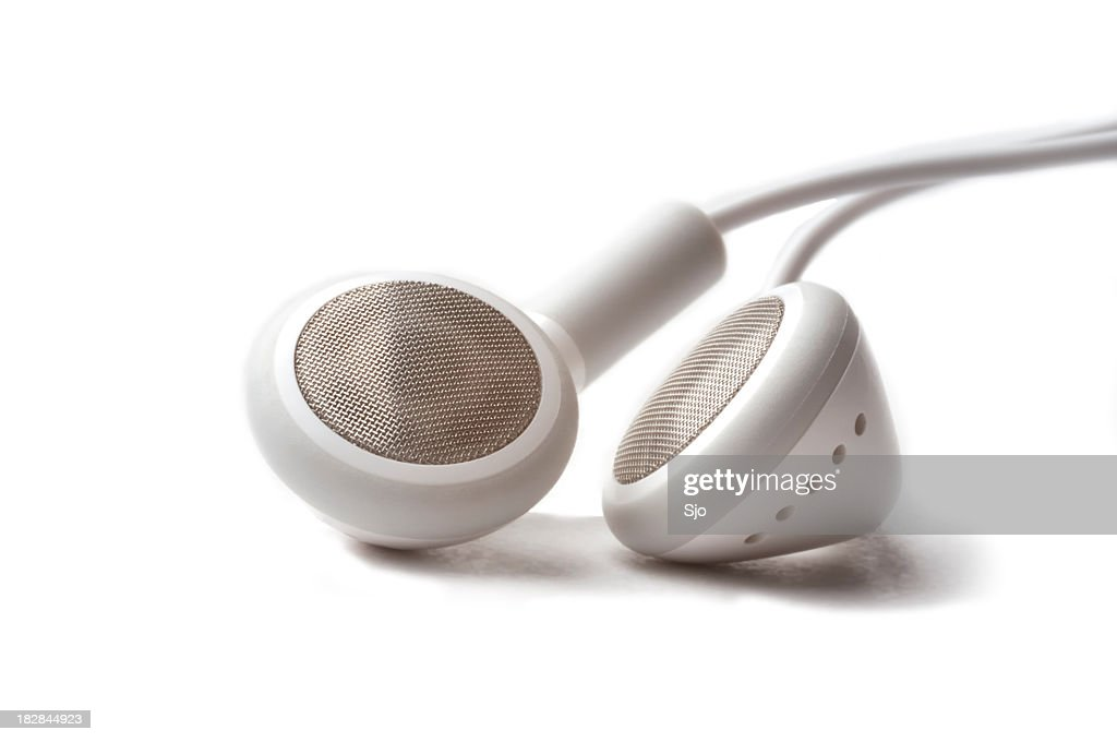 Close up photo of white headphones on a white background