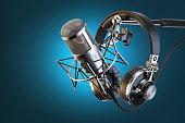 Headphones on microphone stand, professional studio. 3d illustration