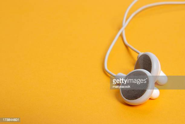 Headphones on orange