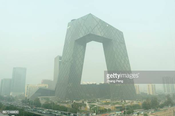 CCTV headquarter building stands in heavy haze A severe air pollution attacks Beijing after the 19th National Congress of CPC