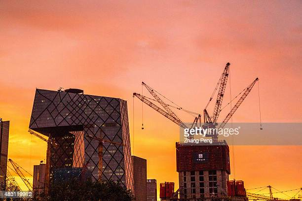CCTV headquarters and a skyscraper under construction during the sunset After a week's sultry and moist days Beijing suddenly welcomes a golden...