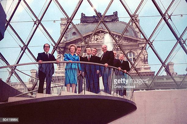 Heads of 7 leading industrial nations and head of EC standin IM Pei's glass pyramid at Louvre Museum LR Japanese PM Uno GB PM Thatcher US Pres Bush...