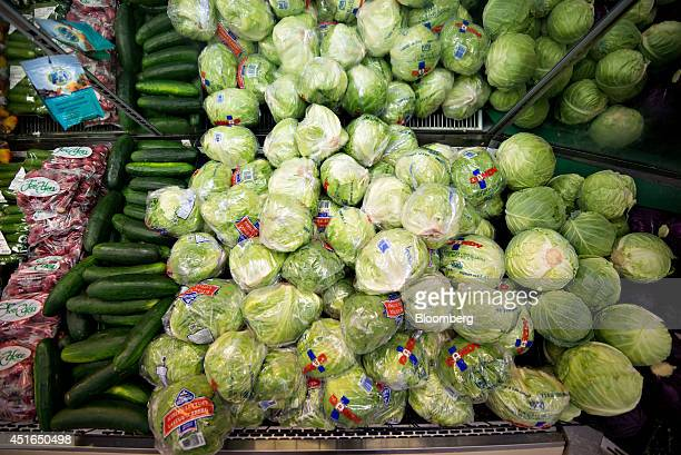 Heads of iceberg lettuce sit on display for sale in a supermarket in Princeton Illinois US on Wednesday July 2 2014 Rising prices for beef ice cream...