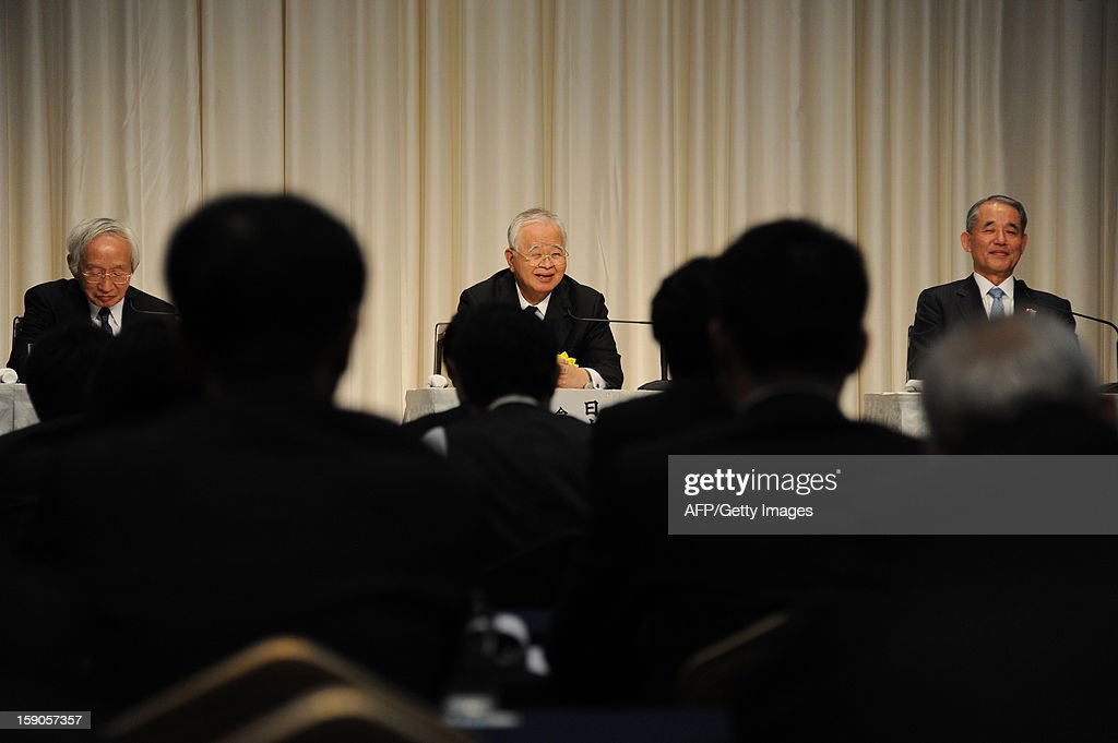 Heads of Japan's three economic organizations, Hiromasa Yonekura (C), chairman of Keidanren (the Japan Business Federation), Yasuchika Hasegawa (R), chairman of Keizai Doyukai (the Japan Association of Corporate Executives), and Tadashi Okamura (L), chairman of the Japan and Tokyo Chambers of Commerce and Industry hold a press conference after a New Year's party at a Tokyo hotel on January 7, 2013. Japan's major business lobbies said they support Prime Minister Abe for his efforts to revive the dwindling economy, urging him an early participation in a Pacific-wide free trade deal.