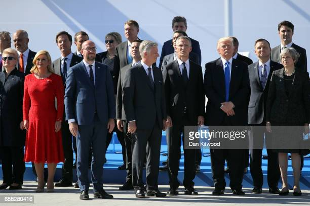 Heads of state including US President Donald Trump and British Prime Minister Theresa May stand during the NATA Summit Opening ceremony on May 25...