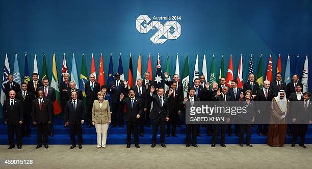 Heads of states and international organizations pose for the 'family photo' during the G20 Summit in Brisbane on November 15 2014 Australia is...