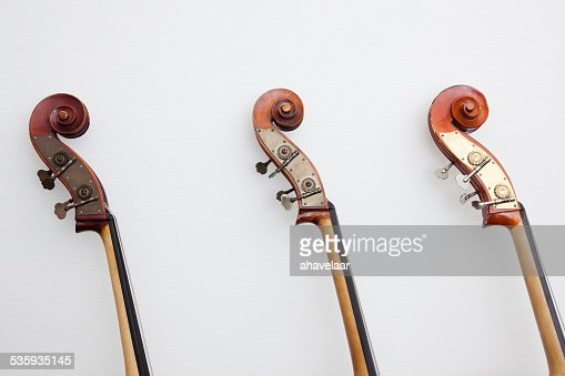 heads of three double basses in a row : Stock Photo