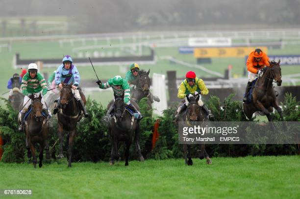 Heads Onthe Ground ridden by jockey Nina Carberry leads The Glenfarclas Cross Country Handicap Steeple Chase followed by Royal County Star ridden by...