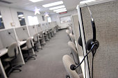A headset hangs on a cubical wall after the last telemarketing shift at Spectrum Marketing Services Inc September 26 2003 in Philadelphia...