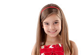 Headshot of adorable little girl with long brown hair and brown eyes.