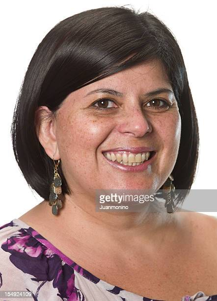 Headshot of a smiling Hispanic woman on a white background.