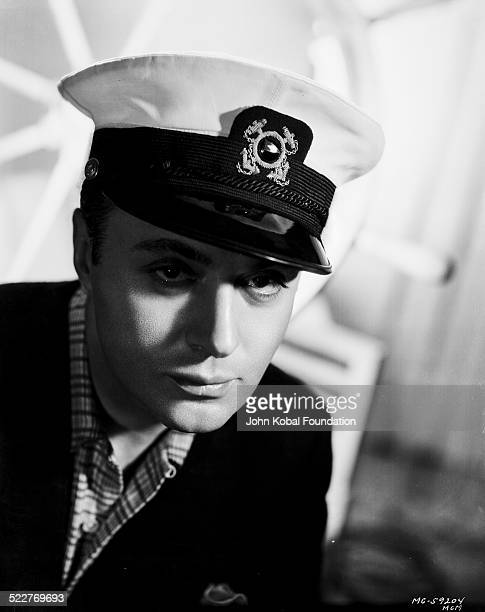 Headshot of actor Charles Boyer wearing a sailor costume for MGM Studios 1937