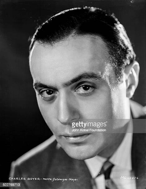 Headshot of actor Charles Boyer wearing a suit and tie for MGM Studios 1931