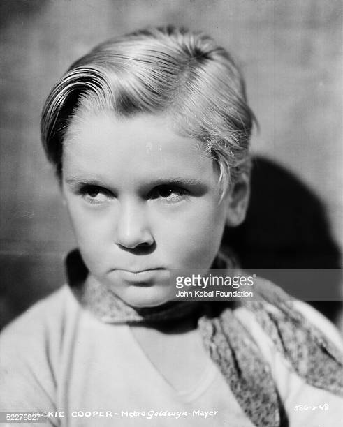 Headshot of actor Jackie Cooper wearing a necktie for MGM Studios 1931