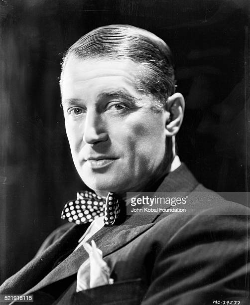 Headshot of actor Maurice Chevalier wearing a suit and bowtie for MGM Studios February 17th 1934