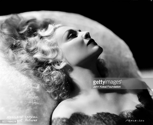 Headshot of actress Madeleine Carroll reclining on a pillow with Paramount Pictures 1938