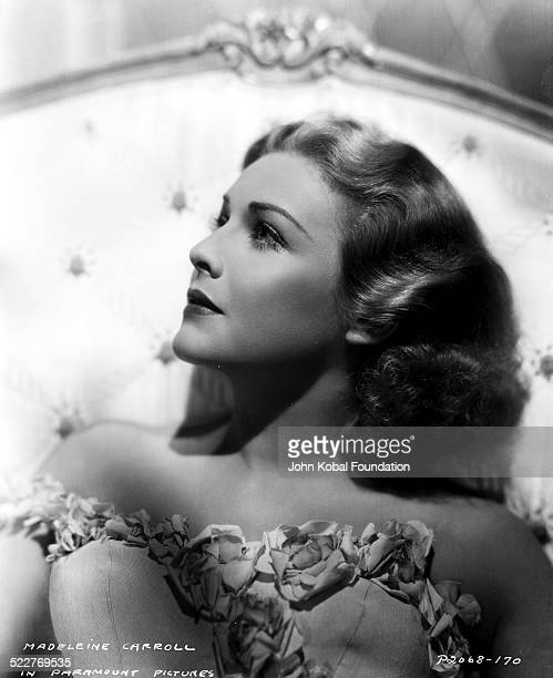 Headshot of actress Madeleine Carroll wearing a strapless flowertrimmed dress with Paramount Pictures 1938