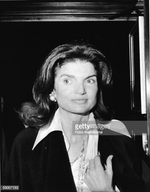 Headshot of American first lady Jacqueline Kennedy Onassis as she stands in a doorway at an invitational preview of the film 'The Day of the Dolphin'...