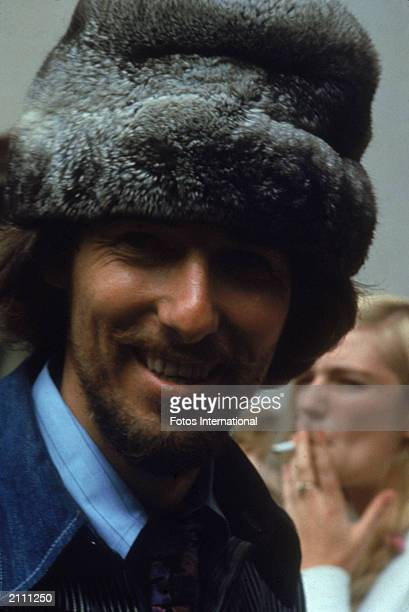 Headshot of American rock singer and songwriter John Phillips of The Mamas and The Papas wearing a fur hat at the Monterey Pop Music Festival...