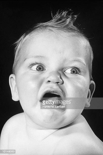HEADSHOT OF AN INFANT CRYING, 1950S