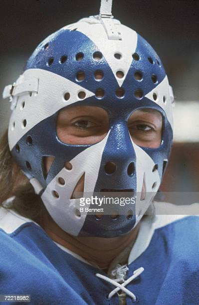Headshot of Canadian professional hockey player Doug Favell goaltender of the Toronto Maple Leafs who wears a fiberglass goalie mask early to mid...