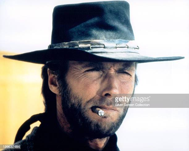 Headshot of Clint Eastwood US actor in costume smoking a cigar in a publicity portrait issued for the film 'High Plains Drifter' USA 1973 The Western...