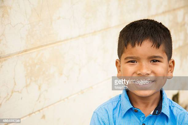 Headshot of cute Latin or Asian boy. Copyspace.