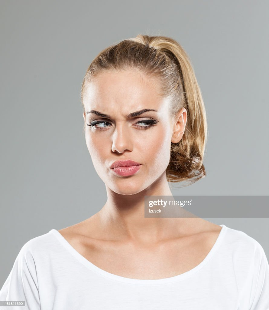 Headshot of disappointed blond hair young woman : Stock Photo