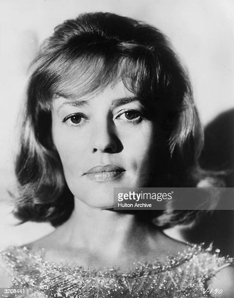 Headshot of French actor Jeanne Moreau wearing a sleeveless metallic blouse