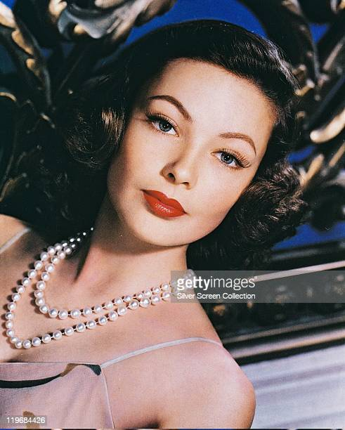 Headshot of Gene Tierney US actress wearing a white pearl necklace in a studio portrait circa 1940