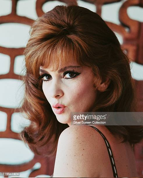 Headshot of Gina Lollobrigida Italian actress pouting as she looks over her shoulder circa 1960