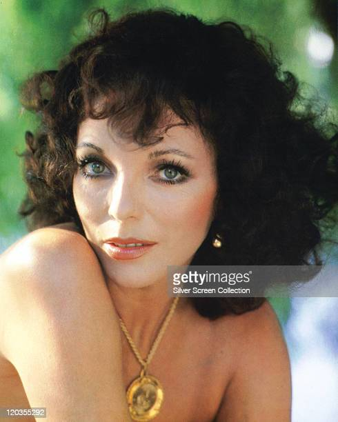 Headshot of Joan Collins British actress with bare shoulders and a gold necklace with a large circular pendant circa 1970