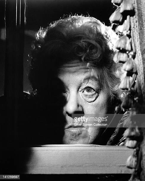 Headshot of Margaret Rutherford British actress in a dramaticallylit image her face emerging from the shadows circa 1950
