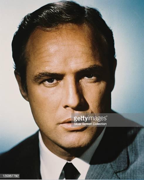 Headshot of Marlon Brando US actor in a studio portrait against a white background circa 1965