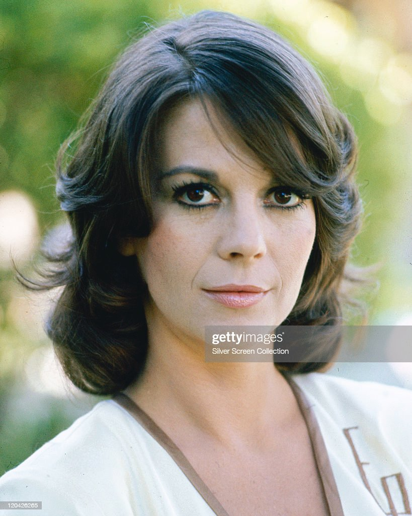 Headshot of Natalie Wood (1938-1981), US actress, wearing a white top with brown trim around the collar, circa 1980.