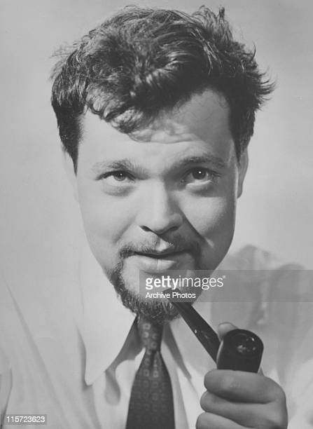 Headshot of Orson Welles US film director actor theatre director screenwriter and producer in a shirt and tie wearing a goatee beard and moustache...