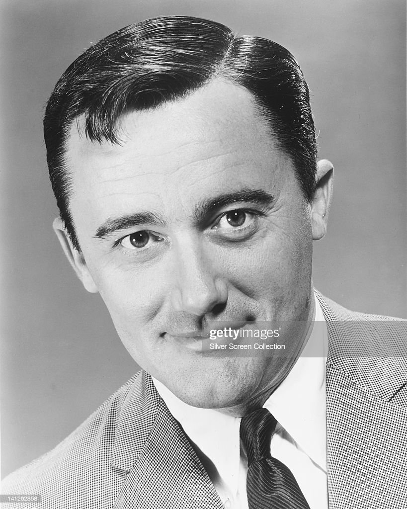Headshot of Robert Vaughn, US actor, wearing a grey jacket, white shirt and black tie, in a publicity portrait issued for the US television series, 'The Man from UNCLE', circa 1965. The espionage series starred Vaughn as 'Napoleon Solo'.