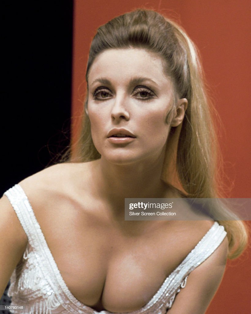 Headshot of <a gi-track='captionPersonalityLinkClicked' href=/galleries/search?phrase=Sharon+Tate&family=editorial&specificpeople=225003 ng-click='$event.stopPropagation()'>Sharon Tate</a> (1943-1969), US actress, wearing a white low cut top, in a studio portrait, against a red and black background, circa 1965.