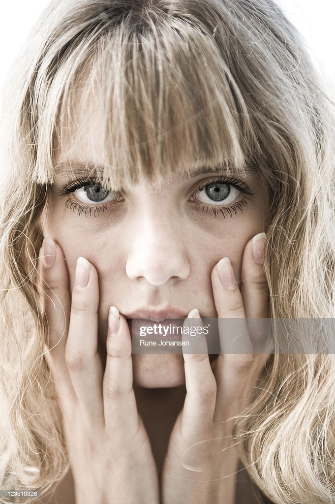 Headshot of teenage model touching her face : Stock Photo