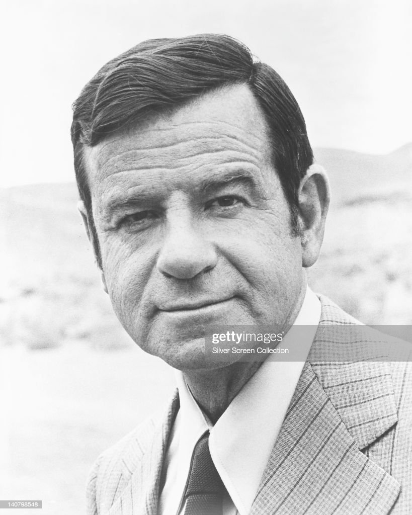Headshot of Walter Matthau (1920-2000), US actor, wearing a tweed jacket over a white shirt and a dark tie, circa 1970.