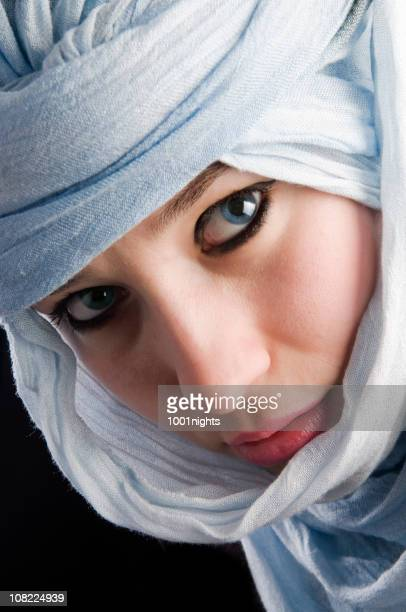 Headshot of Young Woman with Blue Eyes Wearing Headscarf