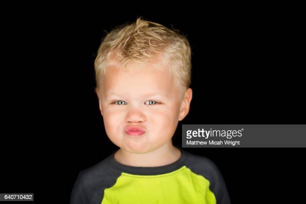 Headshot portrait of a 3 year old boy.