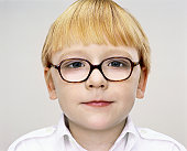 Headshot Portrait of a Young Boy With Glasses