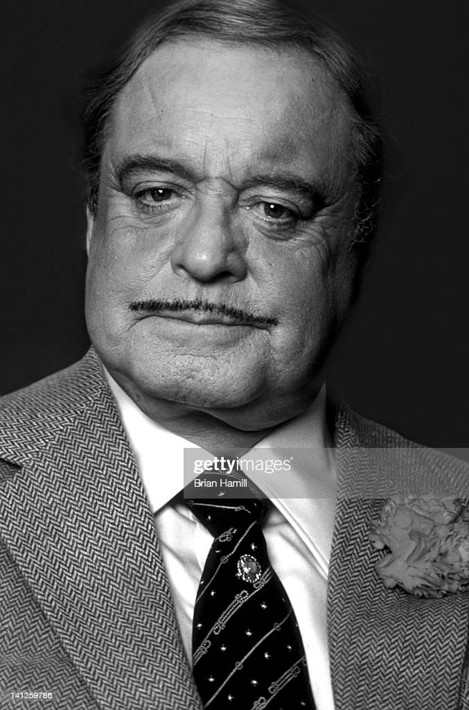 Headshot portrait of American actor and comedian <a gi-track='captionPersonalityLinkClicked' href=/galleries/search?phrase=Jackie+Gleason&family=editorial&specificpeople=203285 ng-click='$event.stopPropagation()'>Jackie Gleason</a> (1916 - 1987) as he wears a carnation in his suit jacket lapel, New York, New York, July 1985.