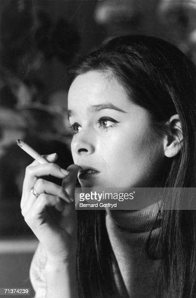 Headshot portrait of American actress Geraldine Chaplin as she smokes a cigarette New York New York 1965