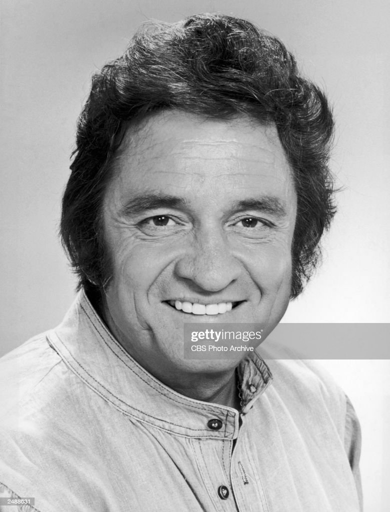 Headshot portrait of American country/western singer and songwriter Johnny Cash (1932 - 2003) smiling, September 1977.