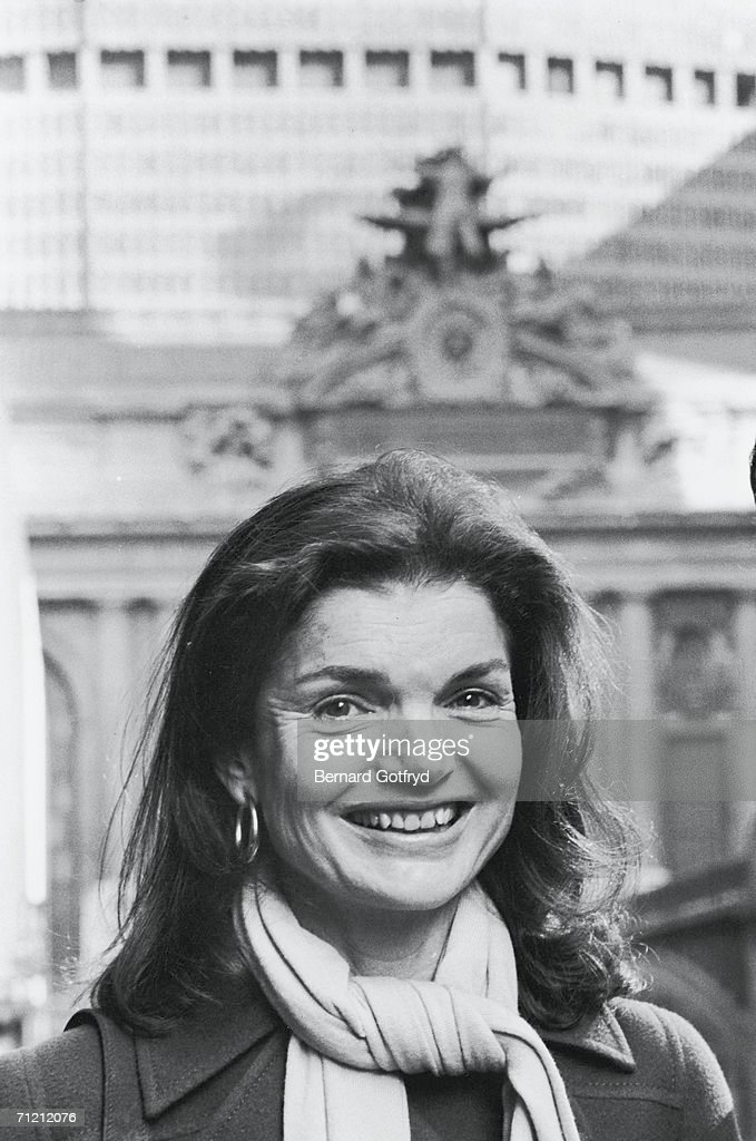 Headshot portrait of American former first lady <a gi-track='captionPersonalityLinkClicked' href=/galleries/search?phrase=Jacqueline+Kennedy&family=editorial&specificpeople=70028 ng-click='$event.stopPropagation()'>Jacqueline Kennedy</a> Onassis (1929 - 1994), who smiles as she stands on the street in front of Grand Central Terminal, New York, New York, 1978. Onassis helped lead a preservation campaign to save Grand Central Station from demolition.