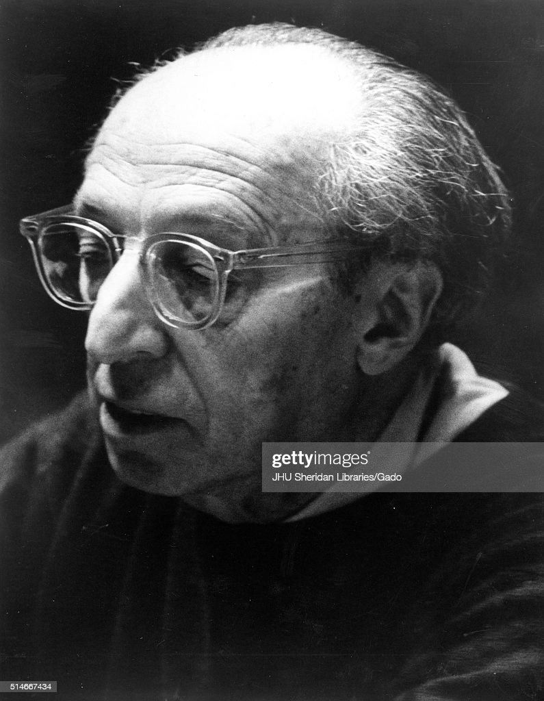 Head-shot portrait of composer and writer <a gi-track='captionPersonalityLinkClicked' href=/galleries/search?phrase=Aaron+Copland&family=editorial&specificpeople=571902 ng-click='$event.stopPropagation()'>Aaron Copland</a>, with thick clear glasses, with a serious facial expression, looking downwards faced to his right, 1975. (Photo by JHU Sheridan Libraries/Gado/Getty Images).